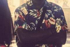 Franklin, wearing 70's Hawaiian shirt, uniform coveralls worn as pants, Esprit shoulder bag and 90's Ralph Lauren sneakers.
