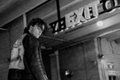 Jack, wearing 80's black Levi's denim jeans, white button up shirt, Carlos Cartagena hand-painted 80's leather biker jacket, 90's black leather boots.