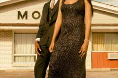 Chelsea, wearing 90's black beaded maxi dress. Franklin, wearing a pin stripe, three-piece suit with a basic white button up shirt and tie.