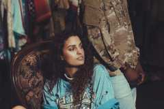 Andrea, wearing a distressed 90's Harley Davidson t-shirt. Tahir, wearing authentic army jacket.