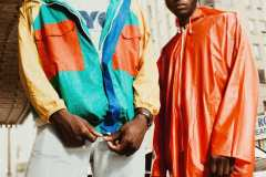 Franklin, wearing 80's washed-out denim, 90's NYC t-shirt, 90's colour-blocked vinyl windbreaker.Tahir, wearing 90's red vinyl rain coat, 80's Adidas high-top sneakers.