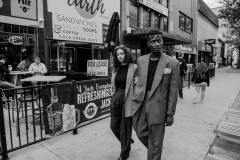 Yumna, wearing 80's pleated, grey wool pants, plaid 80's blazer. Franklin, wearing brown 70's two-piece suit, suspenders, gingham pocket square.