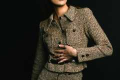 Andrea, wearing a 80's two-piece tweed pant and jacket set.
