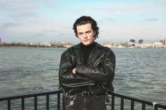 Jack, wearing black Levi's denim jeans, 80's black leather biker jacket.